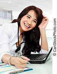 happy young doctor - happy doctor female working in office