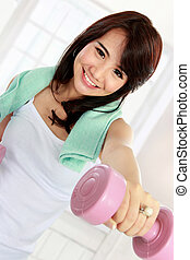 Woman exercising with free-weights - Portrait of fitness...