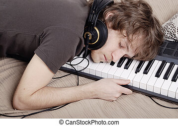 Man asleep on the MIDI-keyboard