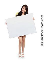 teenager girl holding banner