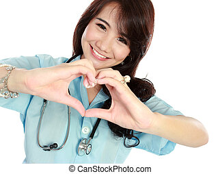 happy young nurse with heart shape - portrait of happy young...