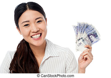 Pretty woman holding a fan of currency notes - Happy woman...