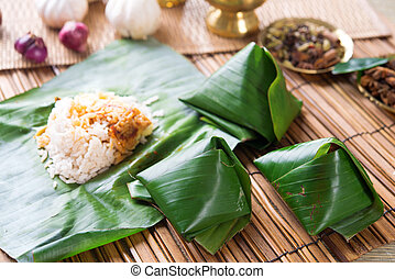 Nasi lemak wrapped with banana leaf. - Nasi lemak, popular...