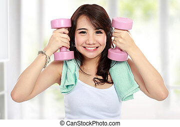fitness woman with free weights - Portrait of Pretty young...