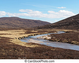 Geusachan burn, Cairngorms mountain, Scotland in spring -...