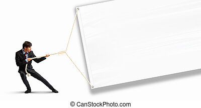 Businessman pulling banner - Image of businessman pulling...