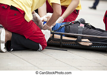 first aid - Paramedic Giving First Aid the Hurt Patient