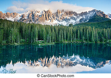 Karersee, lake in the Dolomites in South Tyrol, Italy -...