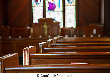 Church Pews with Stained Glass Beyond Pulpit - Stained glass...