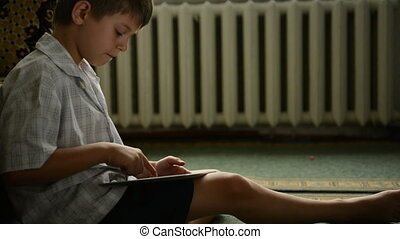 Boy using a tablet pc