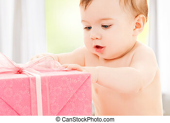 happy child with gift box - bright picture of happy child...