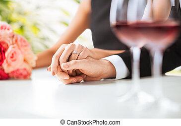 engaged couple with wine glasses - picture of engaged couple...
