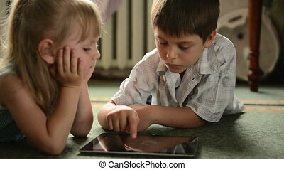 Childs with tablet pc lying on the