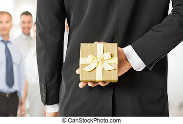 man hands holding gift box in office - close up of man hands...