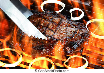 Juicy Steak on Flaming Grill - A delicious thick juicy steak...