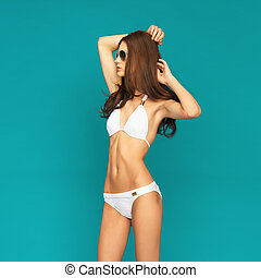 model posing in white bikini - picture of model posing in...