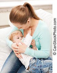 mother and adorable baby with feeding-bottle - happy mother...