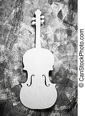 white cello on a grey grunge background