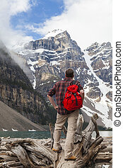 Hiking Man Looking at Moraine Lake and Rocky Mountains -...