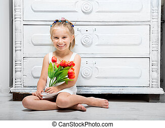 little girl with a bouquet of flowers