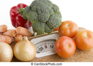 Weight Loss - Garden vegetables on a bathroom scale