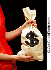 Cash - A professional woman presents a cashbag full of money...