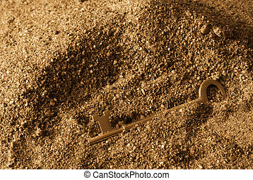 Lost Secrets - A skeleton key is found in the sandy ground...