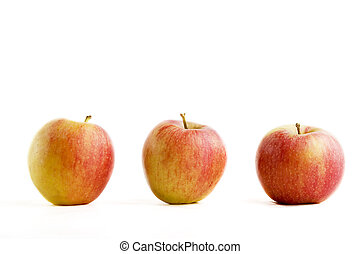 Apple Group - A group of three apples isolated on white.