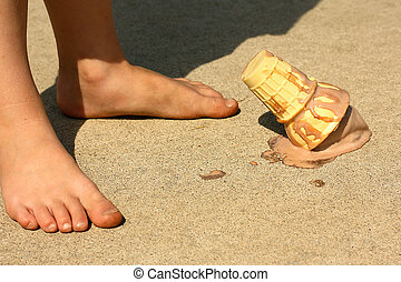 Child Drops Ice Cream Cone by Feet