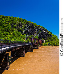 Pedestrian and train bridge across the flooded Potomac River in Harper's Ferry, West Virginia.