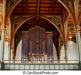 Pipe Organ - A pipe organ in an old wooden church