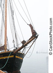 Pirate Ship in Fog - An old wooden sail ship in thick fog.