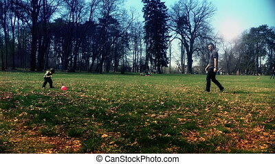 Father and son in the park, playing