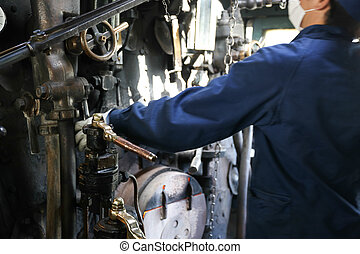 Stream train worker inside the cockpit