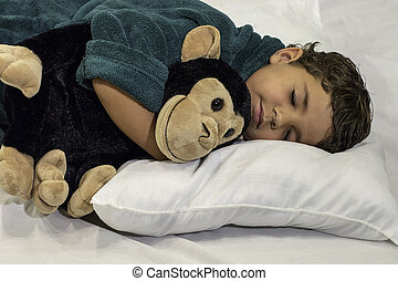 Child - Sleeping with stuffed anima - A child sleeping...