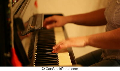 piano - woman playing the piano