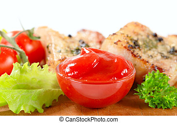 Tomato dipping sauce and herb-rubbed pork meat