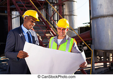 industrial engineers with blueprint - industrial engineers...