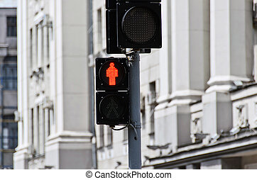 Red traffic light on a city street
