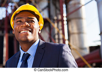 african industrial manager at oil refinery plant - happy...