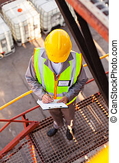 oil chemical worker working in refinery plant - senior oil...
