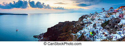Sunset at Oia Santorini - Panoramic shot at sunset over...