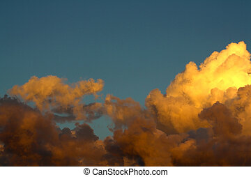 Golden Clouds - Idyllic clouds on bright gold and orange...