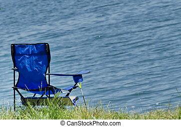 Folding fishing chair at shore of Iskar dam