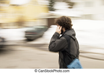Late Concept - A motion blur abstract of a person walking in...