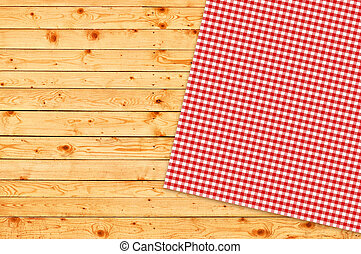 Table napkin - Table kitchen napkin on wooden background.