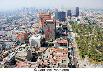 Aerial view of Mexico City with traffic and smog