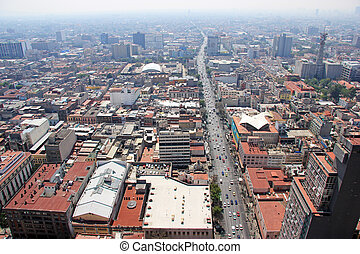 Aerial view of Mexico City, with traffic and smog