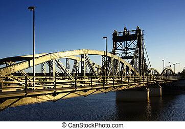 Iron Bridge - Old iron drawbridge painted green in the...