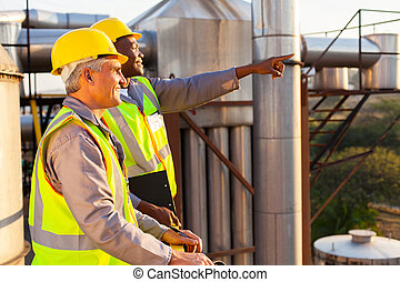 chemical factory workers - two chemical factory workers...